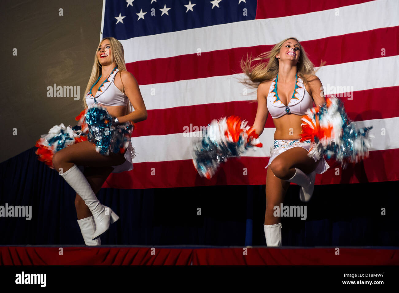 Miami Dolphins cheerleaders Lily and Alison perform cheers for deployed service members at the Manas Transit Center February 7, 2014 in Manas, Kyrgyzstan. - Stock Image