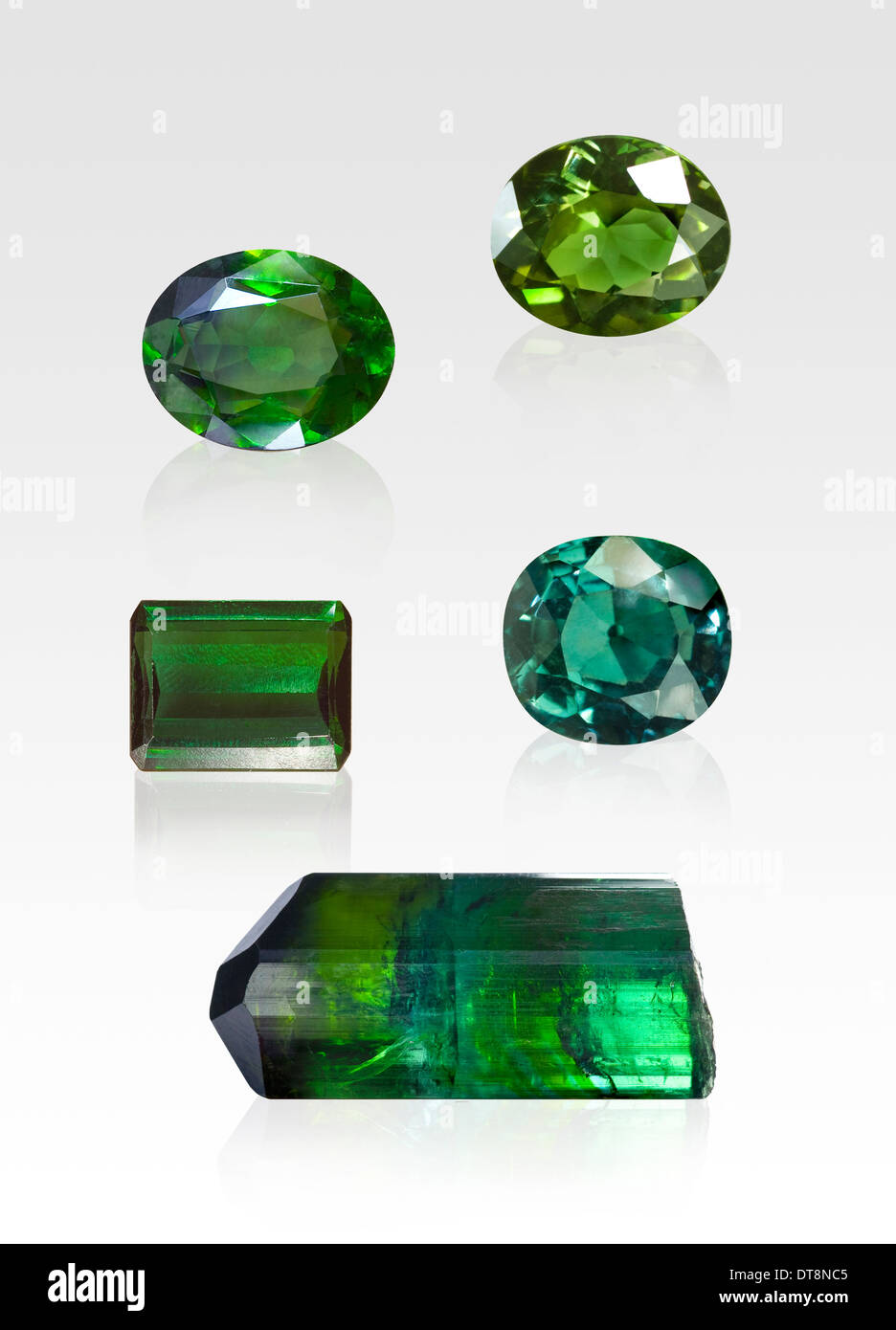 on white tourmaline gemstones photo gemstone green stock background