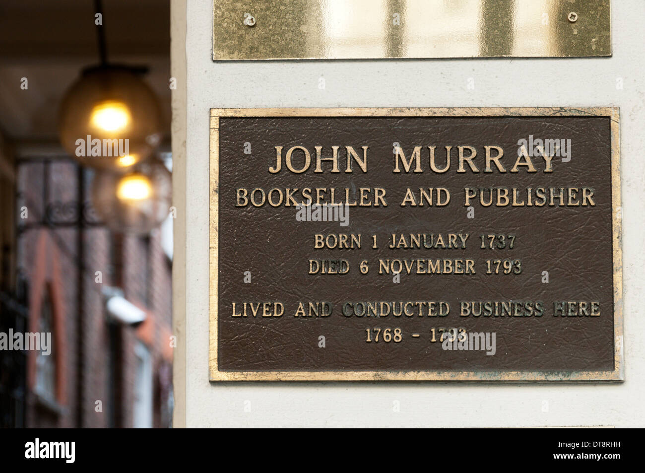 A plaque on the building occupied by the eighteenth century bookseller and publisher, John Murray. - Stock Image