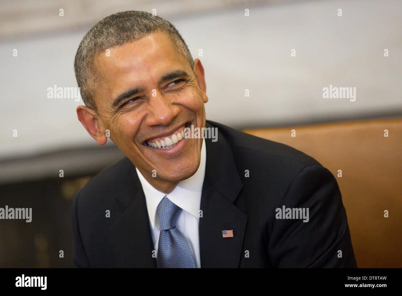 Washington DC, USA. 11th Feb, 2014. United States President Barack Obama smiles while meeting with President Francois Stock Photo