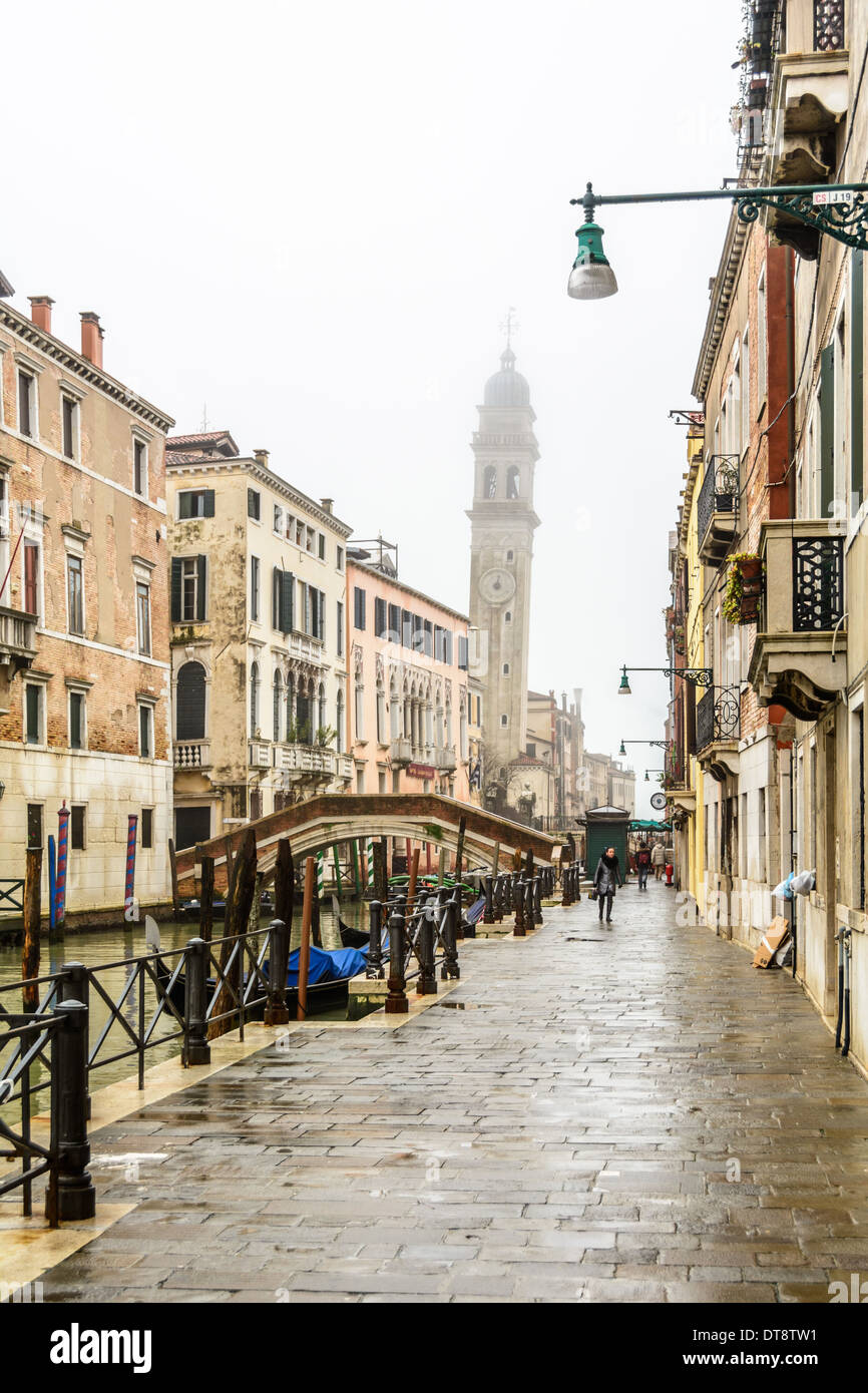 Venice, Italy. Canal, bridge, and the leaning belltower (campanile) of San Giorgio dei Greci, Saint George of the Stock Photo