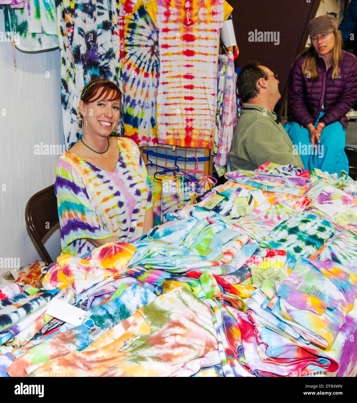 Vendor selling tie-dyed tee shirts at the Ark Valley HIgh Rollers Roller Derby, Chaffee County Fairgrounds, Colorado, - Stock Image