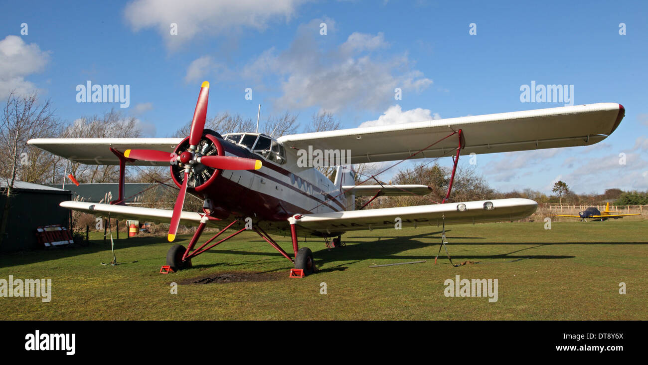 an Antonov AN2 aircraft parked on the ground at Hinton-in-the-Hedges Airfield - Stock Image