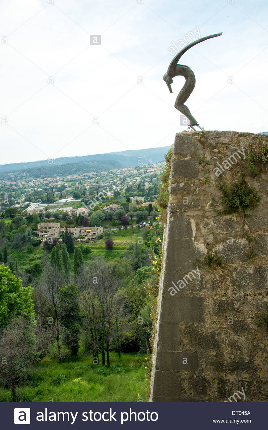 sculpture on the old walls of St Paul de Vince, France - Stock Image