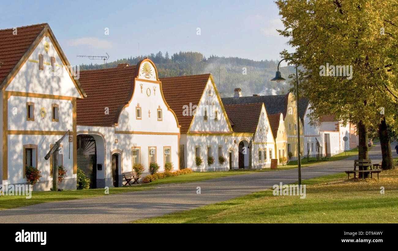 Rustic houses on the small village of Holasovice, South Bohemia, Czech Republic. - Stock Image