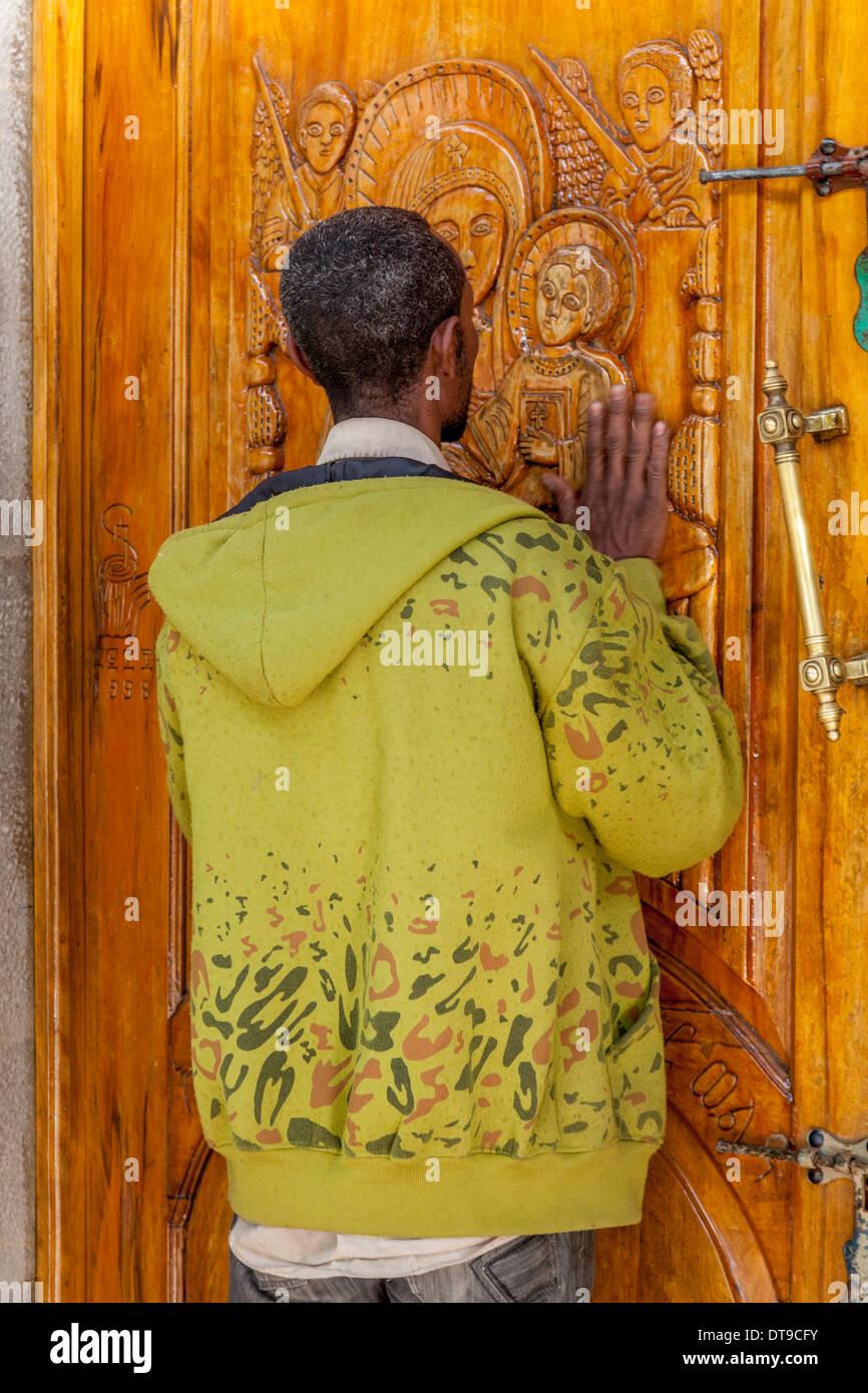 A Man Prays At The Door Of St Gabriel Church, Hawassa, Ethiopia - Stock Image