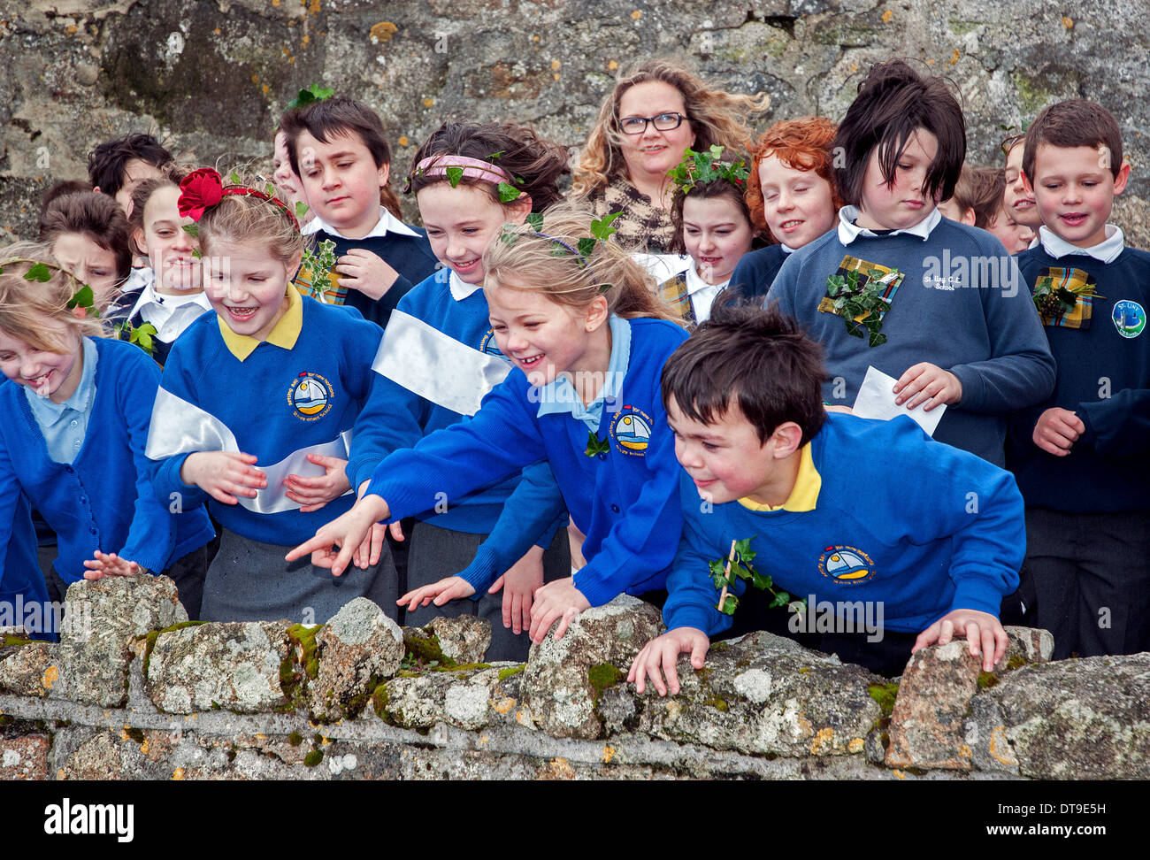 primary school children enjoying the feast day celebrations in St.Ives, Cornwall, UK - Stock Image