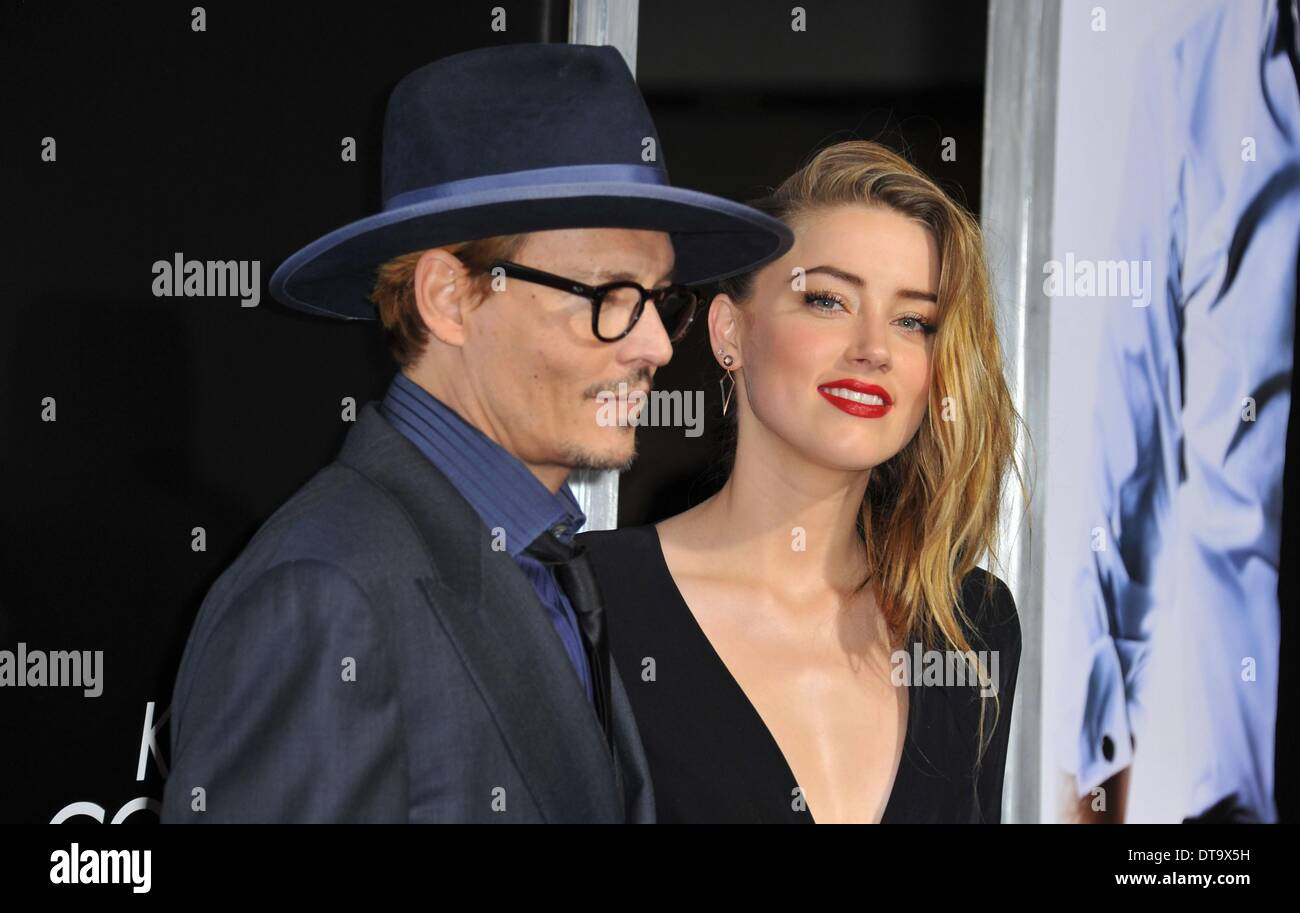 Los Angeles, CA, USA. 12th Feb, 2014. Johnny Depp, Amber Heard at arrivals for 3 DAYS TO KILL Premiere, ArcLight Cinemas, Los Angeles, CA February 12, 2014. Credit:  Dee Cercone/Everett Collection/Alamy Live News - Stock Image