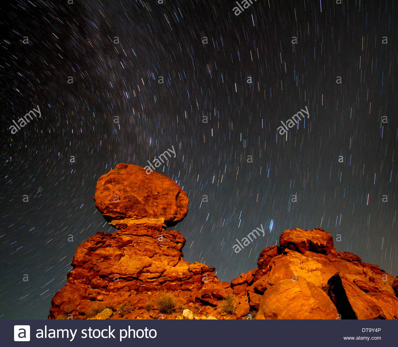 Stars Over Balanced Rock, Arches National Park, Utah, USA - Stock Image