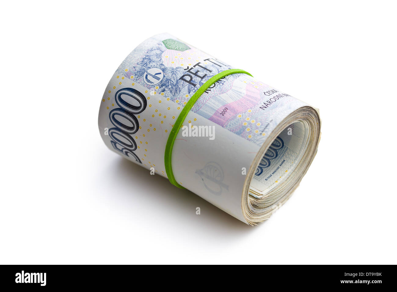 the roll of czech money on white background - Stock Image