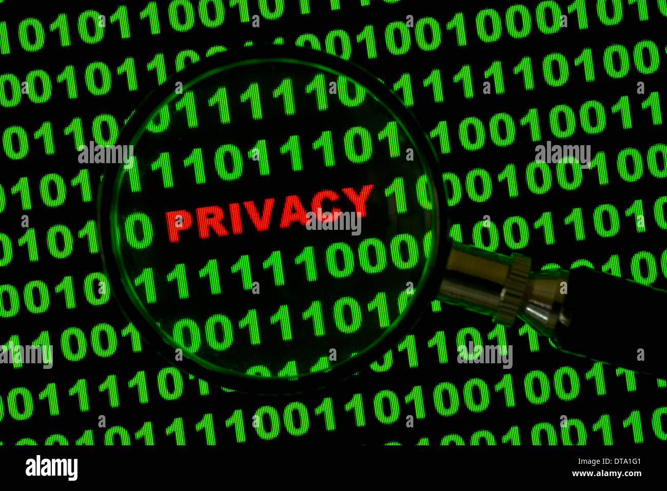 Binary code with the word 'Privacy' viewed through a magnifying glass - Stock Image