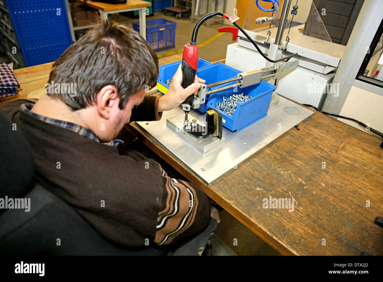 Mentally and physically disabled man at work - Stock Image