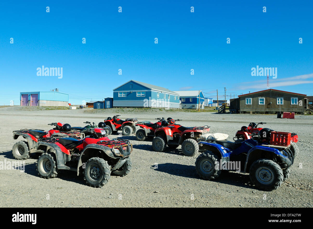 Car park with several quad bikes, ATV, in the Inuit village of Ulukhaktok, Victoria Island, formerly Holman Island - Stock Image