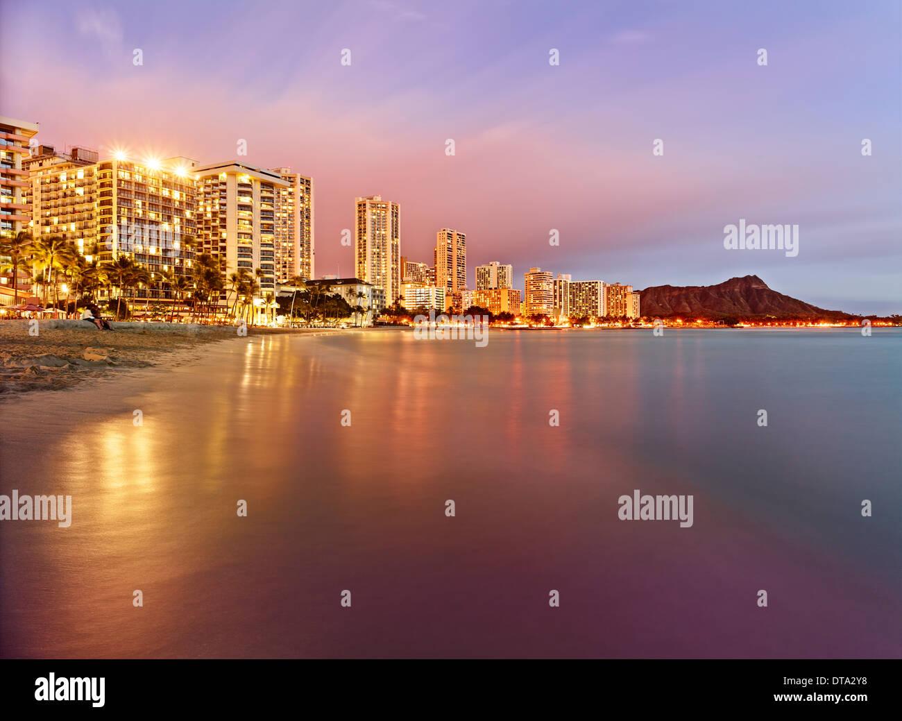 Waikiki Beach at dusk, Honolulu, Oahu, Hawaii, USA - Stock Image