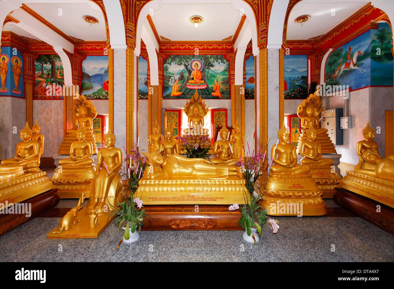 Gilded Buddha statues and reclining Buddhas, Wat Chalong temple, Phuket, Thailand - Stock Image