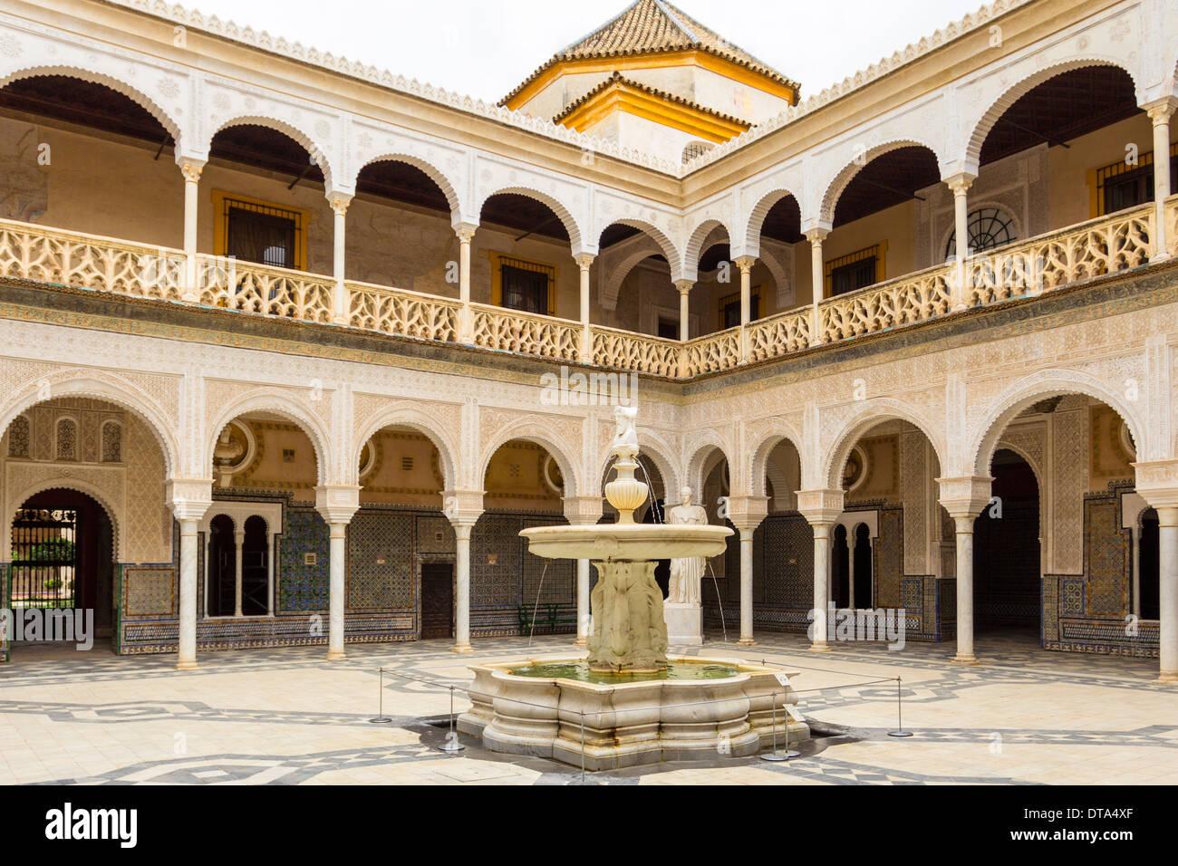 SEVILLE SPAIN INTERIOR COURTYARD AND FOUNTAIN OF THE CASA DE PILATOS Stock Photo