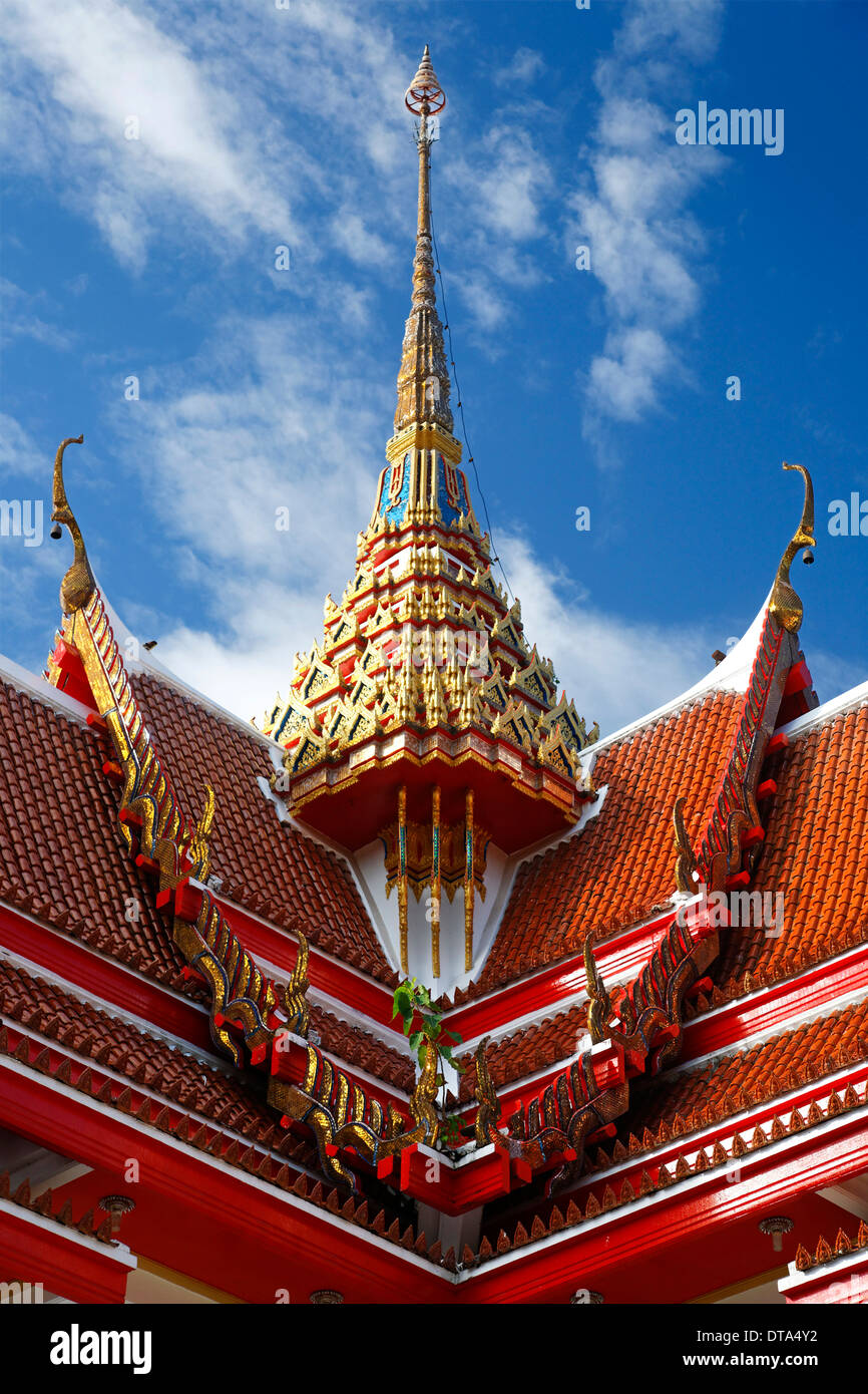 Red roof of a pagoda with an ornate spire, Wat Chalong temple, Phuket, Thailand - Stock Image