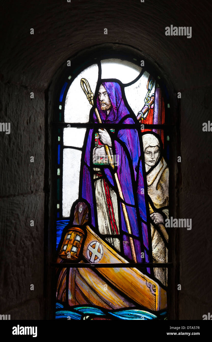 Colourful stained glass window, Saint Columba of Iona, Irish monk and missionary in Scotland, St. Margaret's Chapel - Stock Image