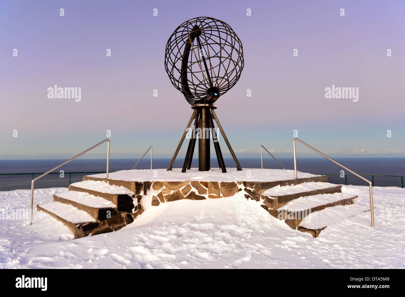 Winter at Nordkapp with globe sculpture, near Honningsvåg, Finnmark, Norway, the most northern point in Europe - Stock Image