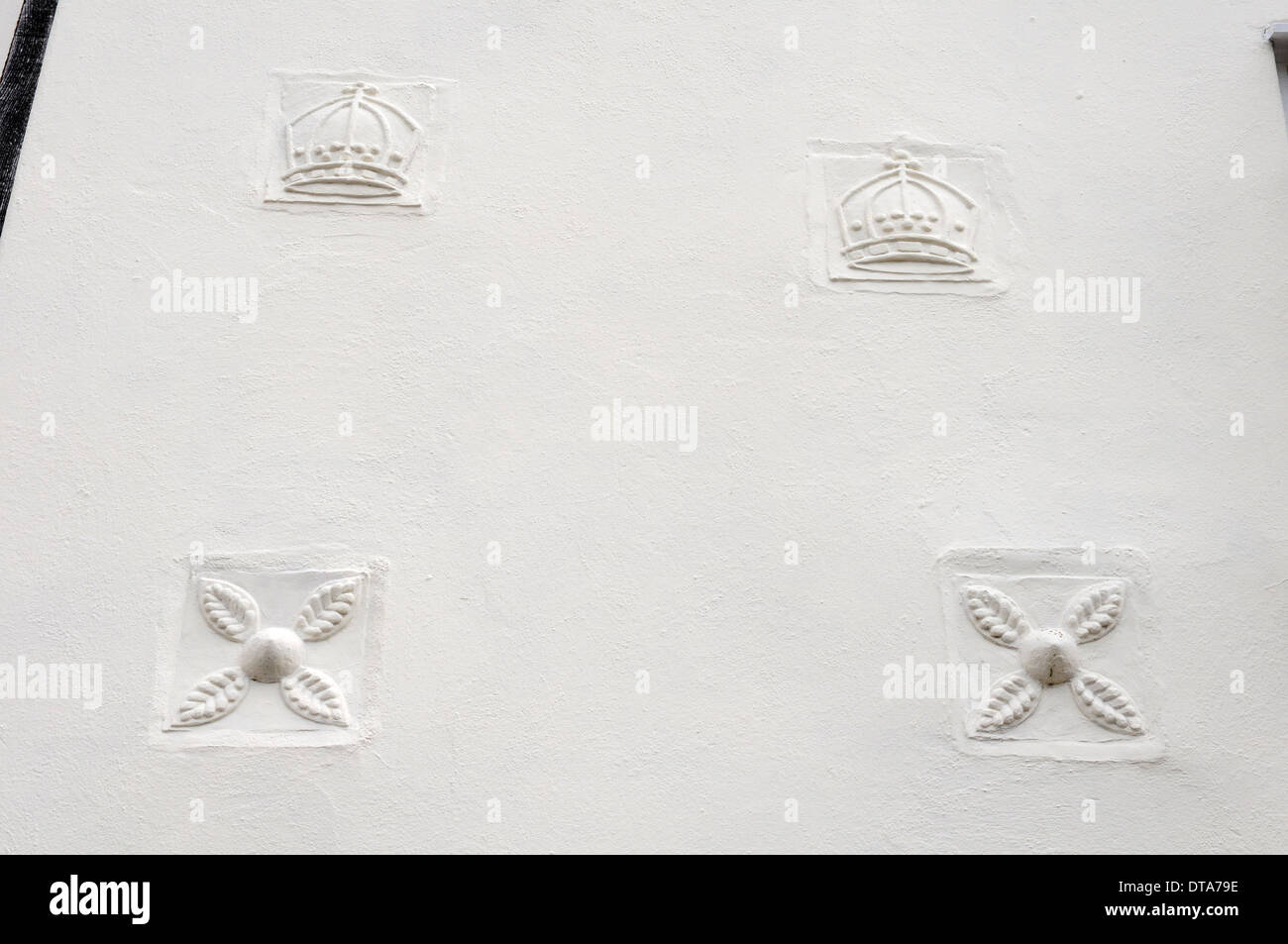 Marks, badges in a wall, Lavenham Suffolk. - Stock Image