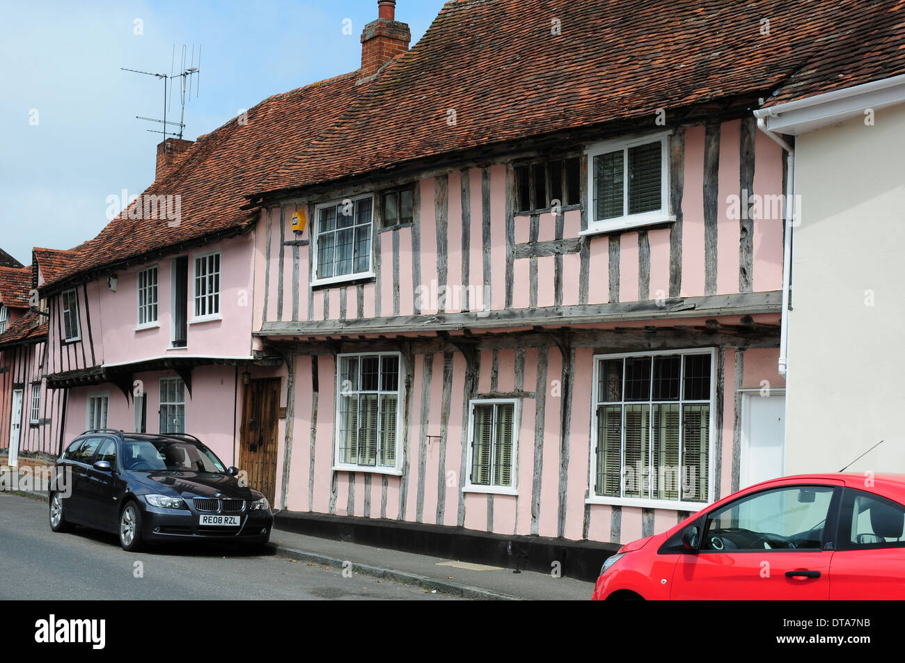 Pink washed timberframed houses in Water Street, Lavenham, Suffolk. - Stock Image