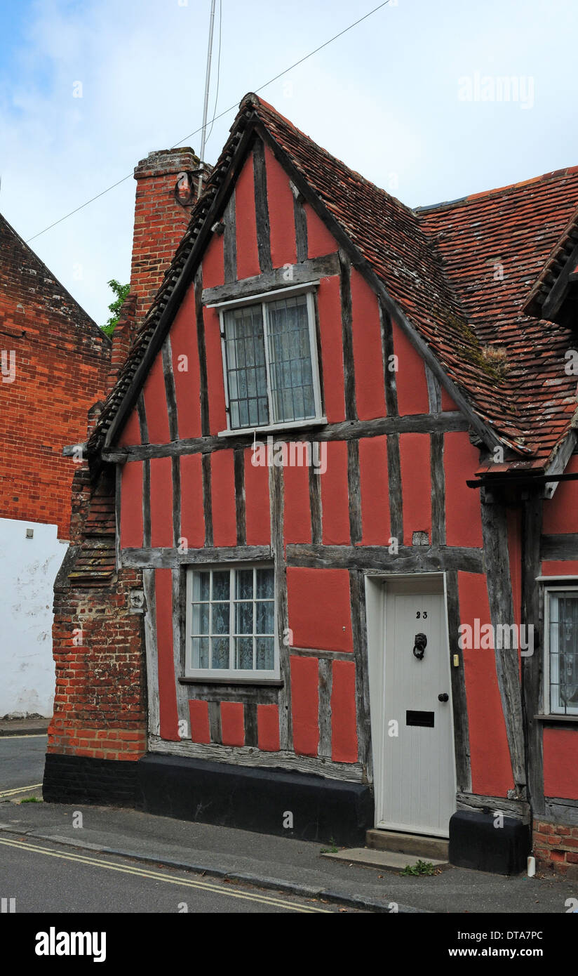 Red painted timberframed house in Lavenham. - Stock Image