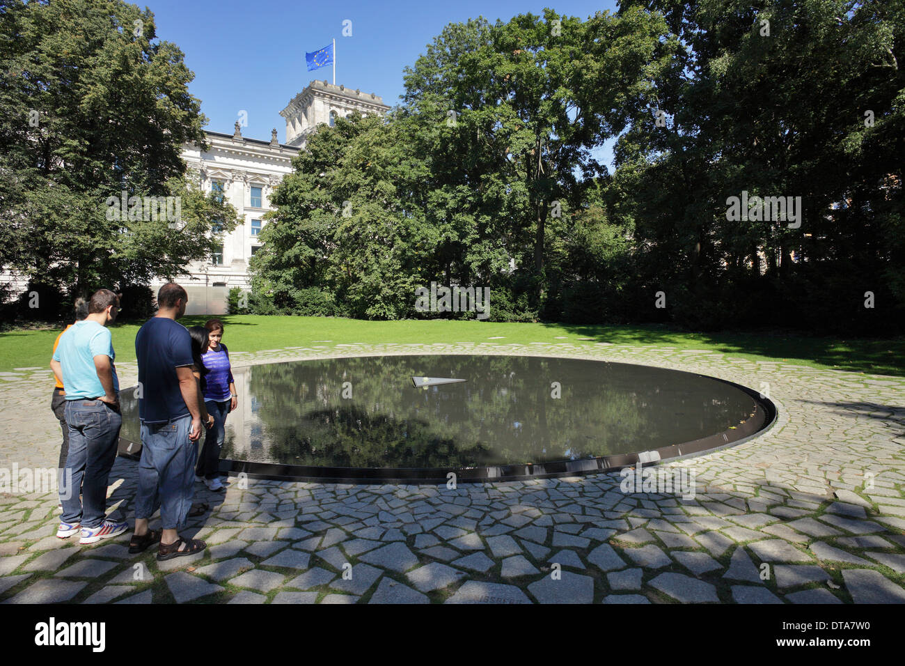 Berlin, Germany, passers-by on the Sinti and Roma Memorial in Berlin-Tiergarten Stock Photo