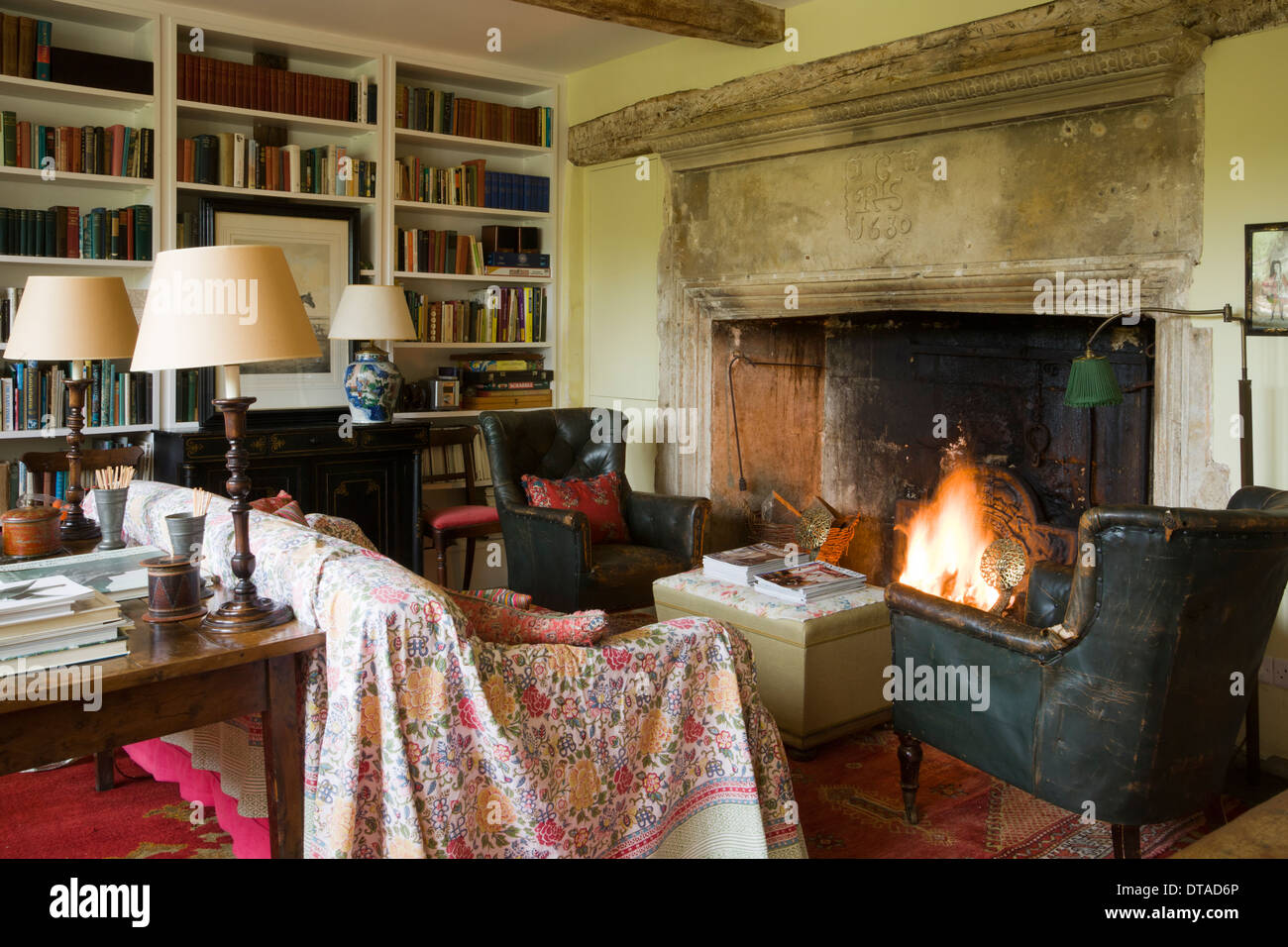 Period house shabby chic sitting room with a large open fireplace. - Stock Image