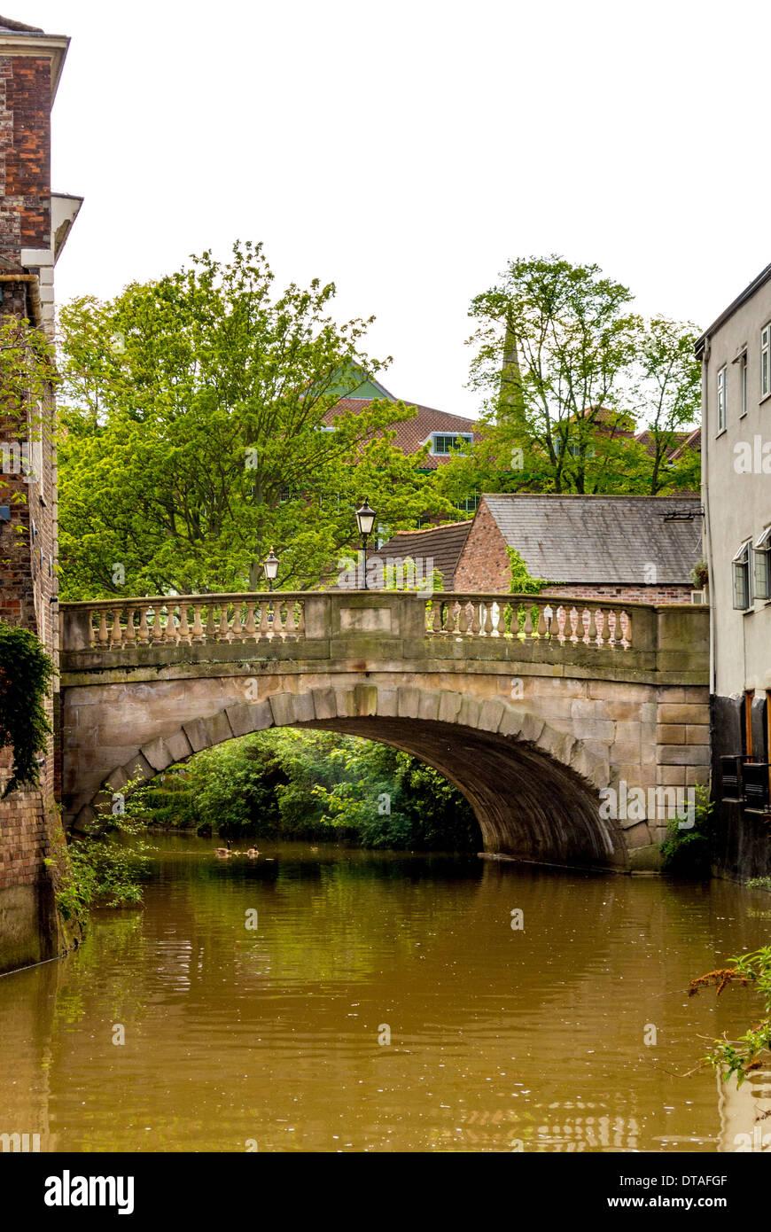 Fossgate Bridge over River Foss, York. - Stock Image