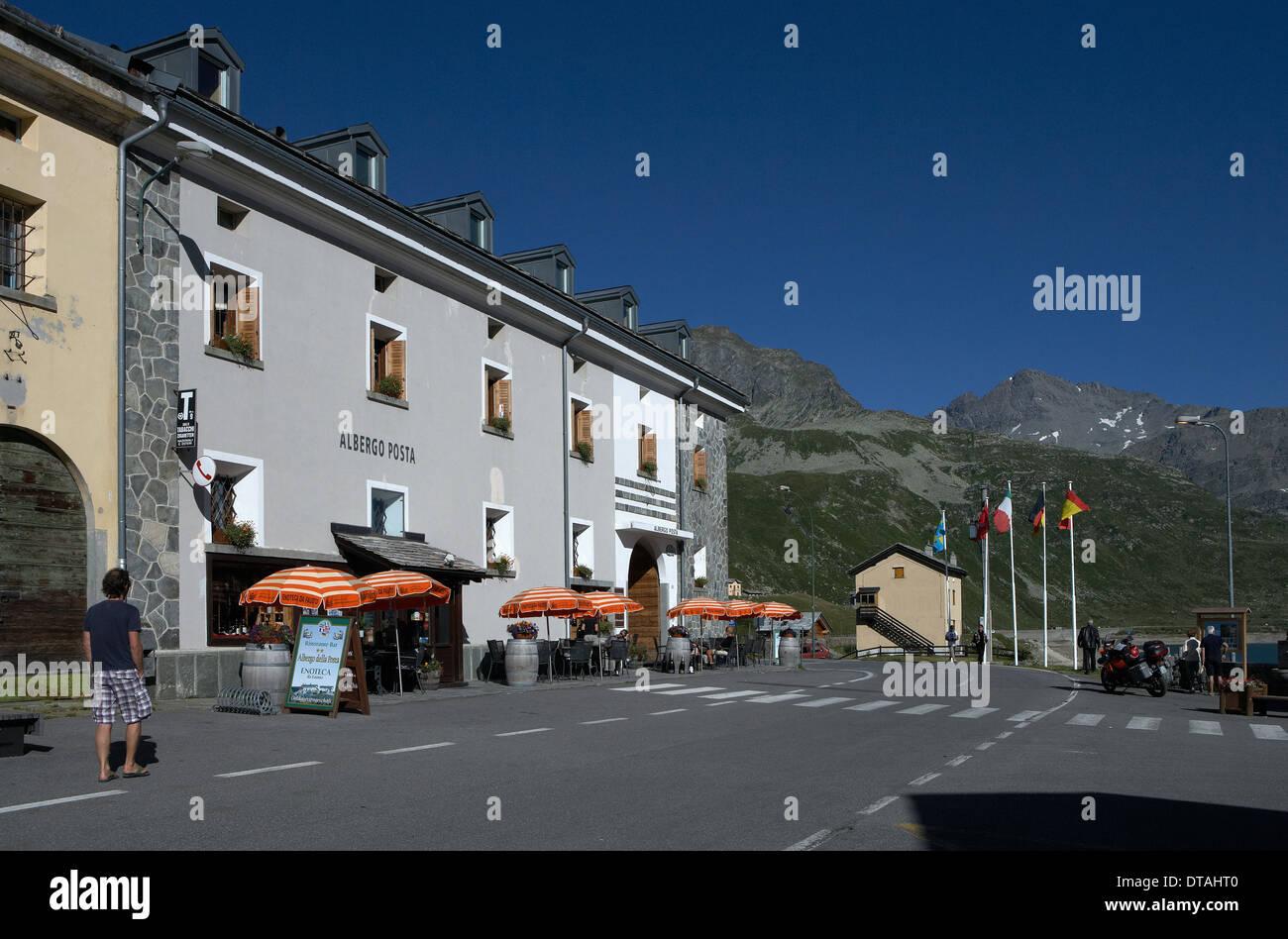 Montespluga, Italy, umbrellas in front of the Albergo della Posta Guest House - Stock Image
