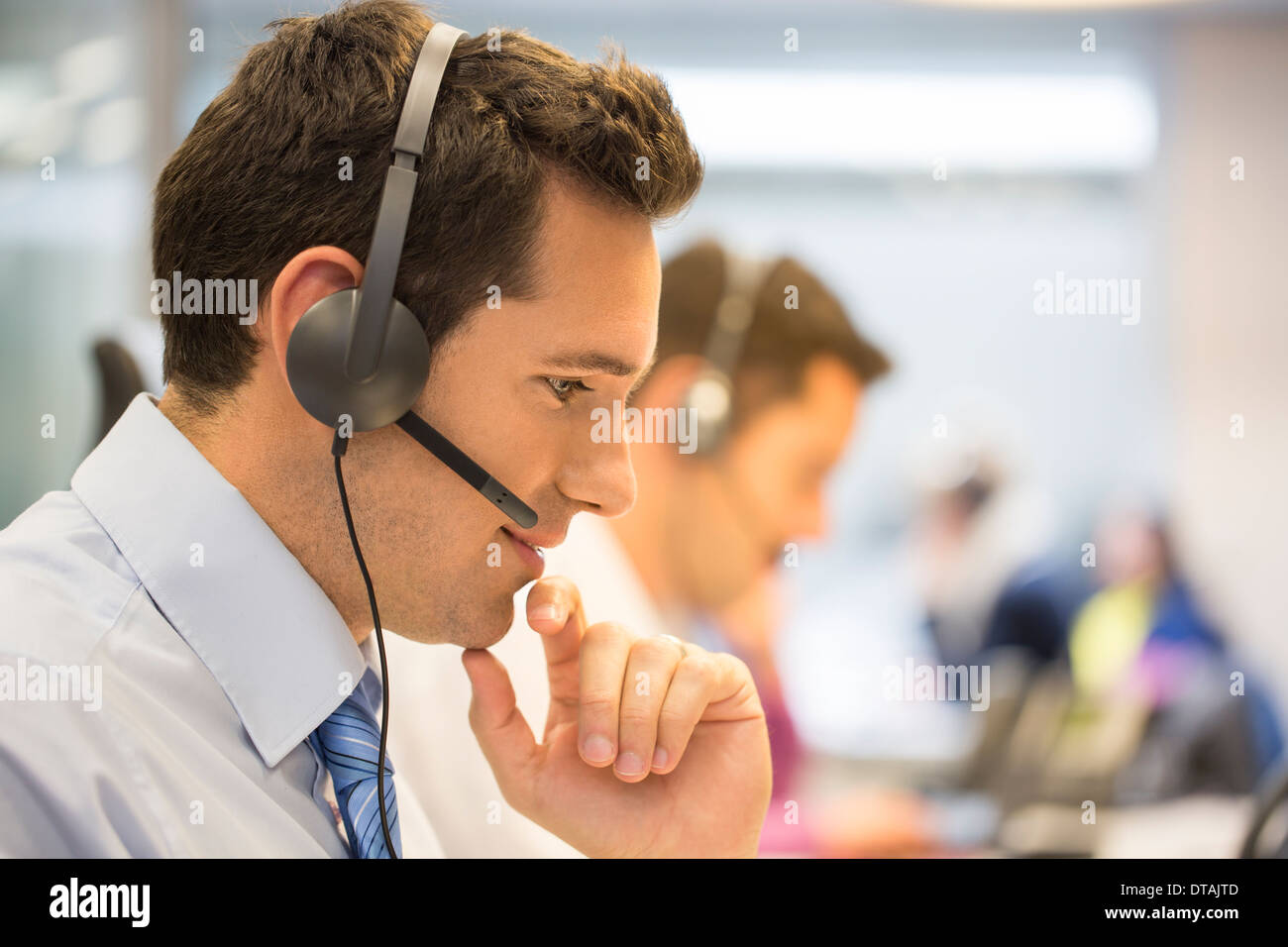 Businessman talking in the micro operator in the office - Stock Image