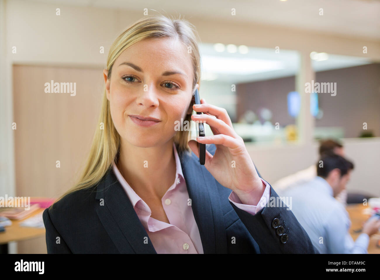 Businesswoman telephoning in her office Stock Photo