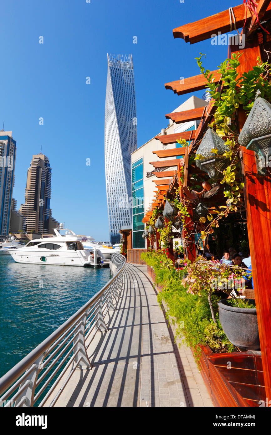 Dubai Marina, restaurant and twisted tower on the back - Stock Image