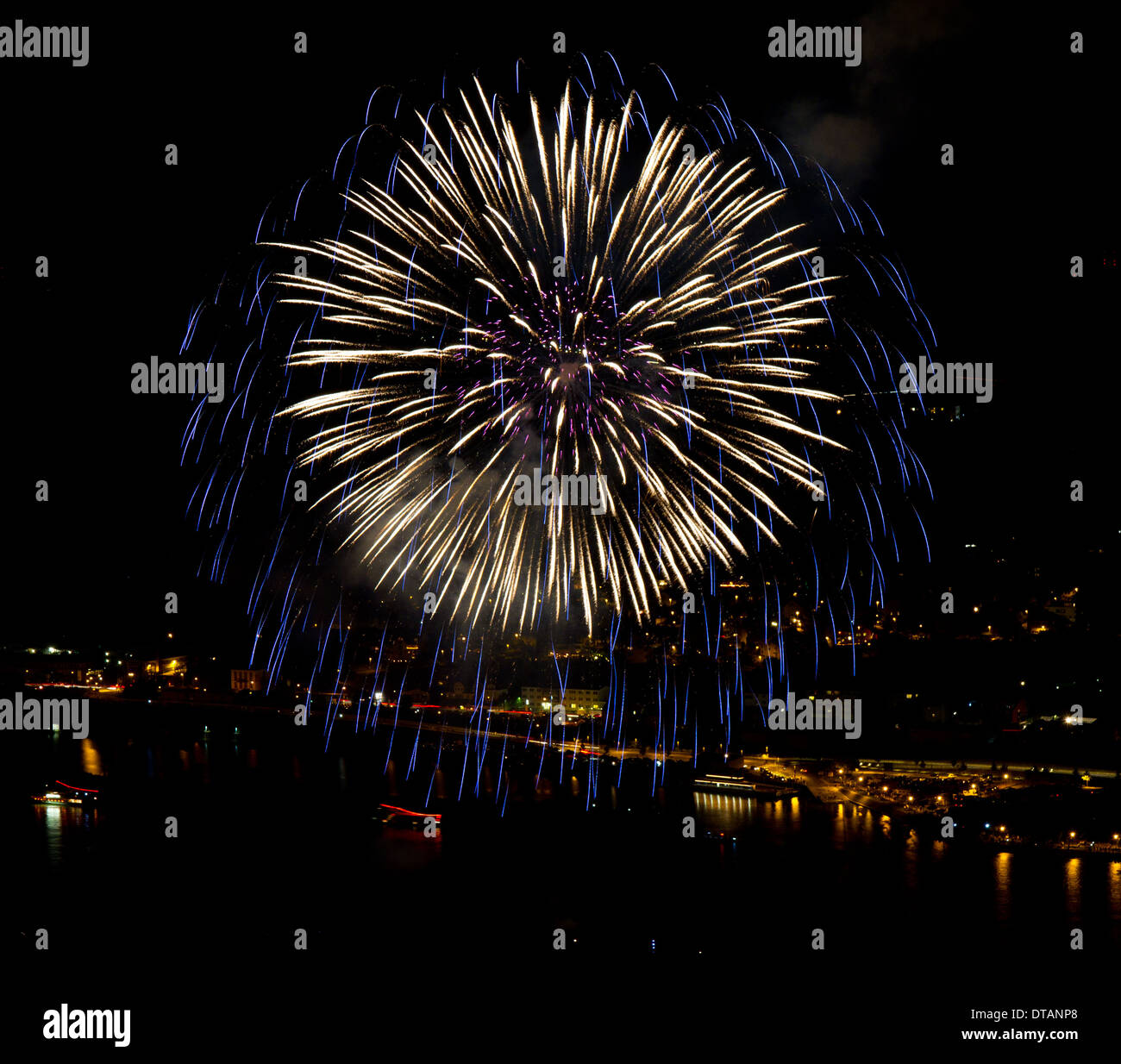 Fireworks over the Rhine river with illuminated boats - Stock Image