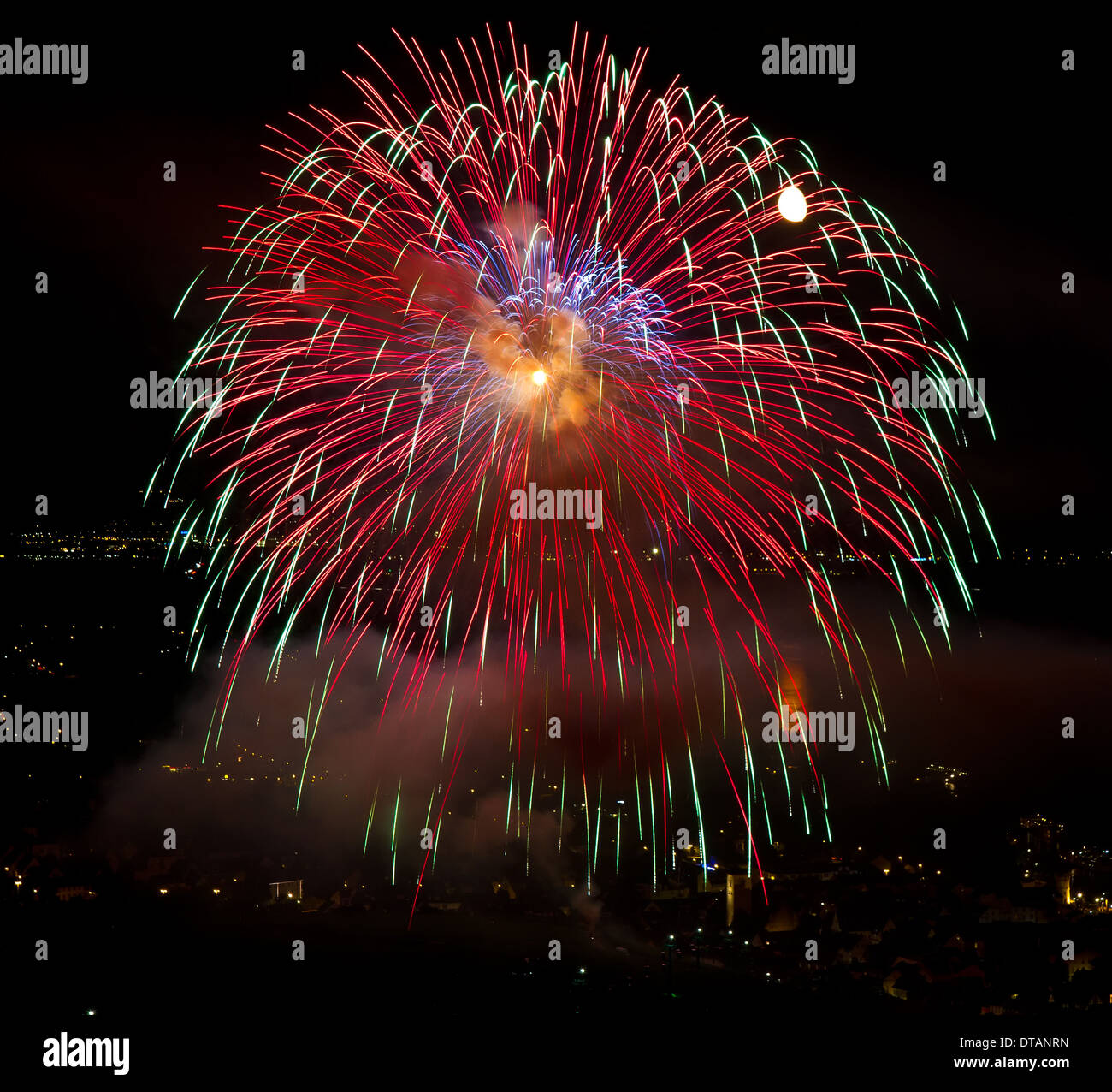 Colourful Fireworks with City lights - Stock Image