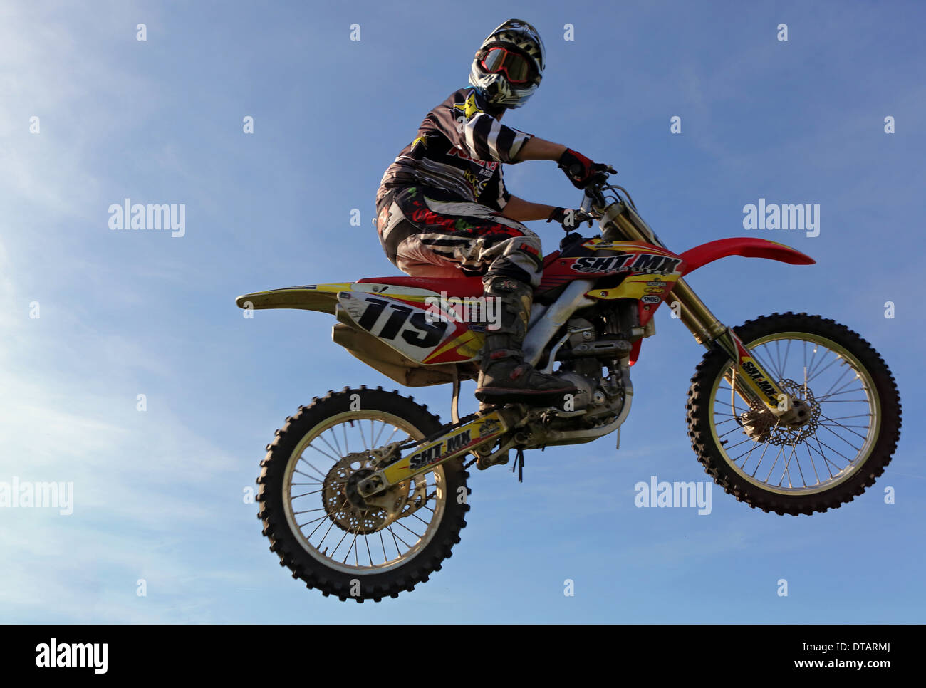 Hannover, Germany, motocross rider flies through the air - Stock Image