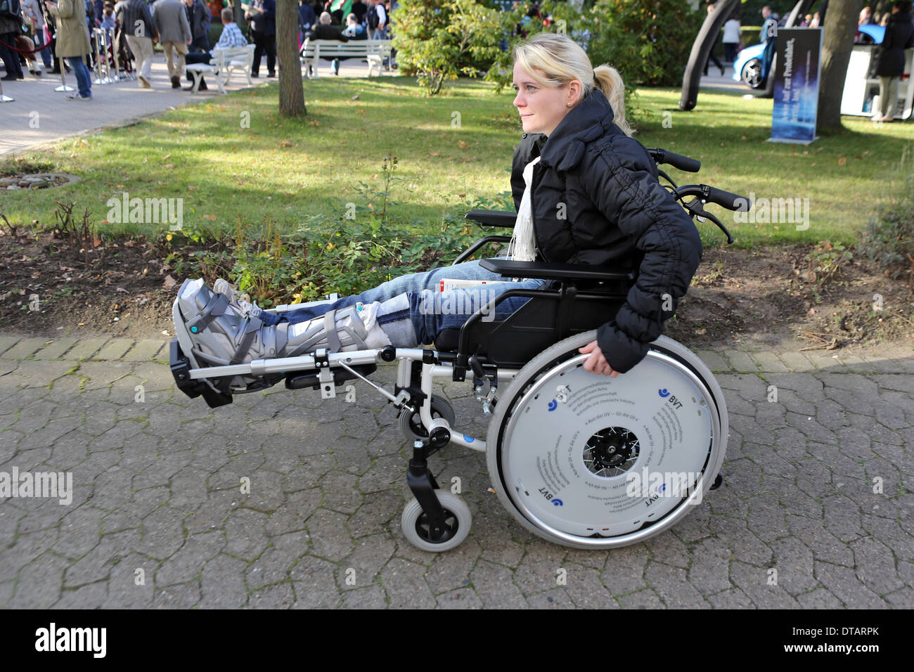 Hannover, Germany, woman with lower leg orthosis is in a wheelchair - Stock Image