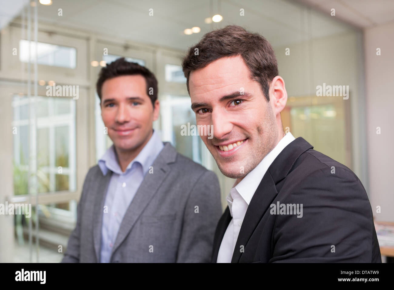 Portrait of Two smiling businessmen in office, looking camera Stock Photo