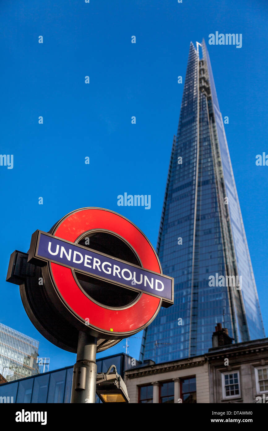 London Underground Sign and The Shard, London, England - Stock Image