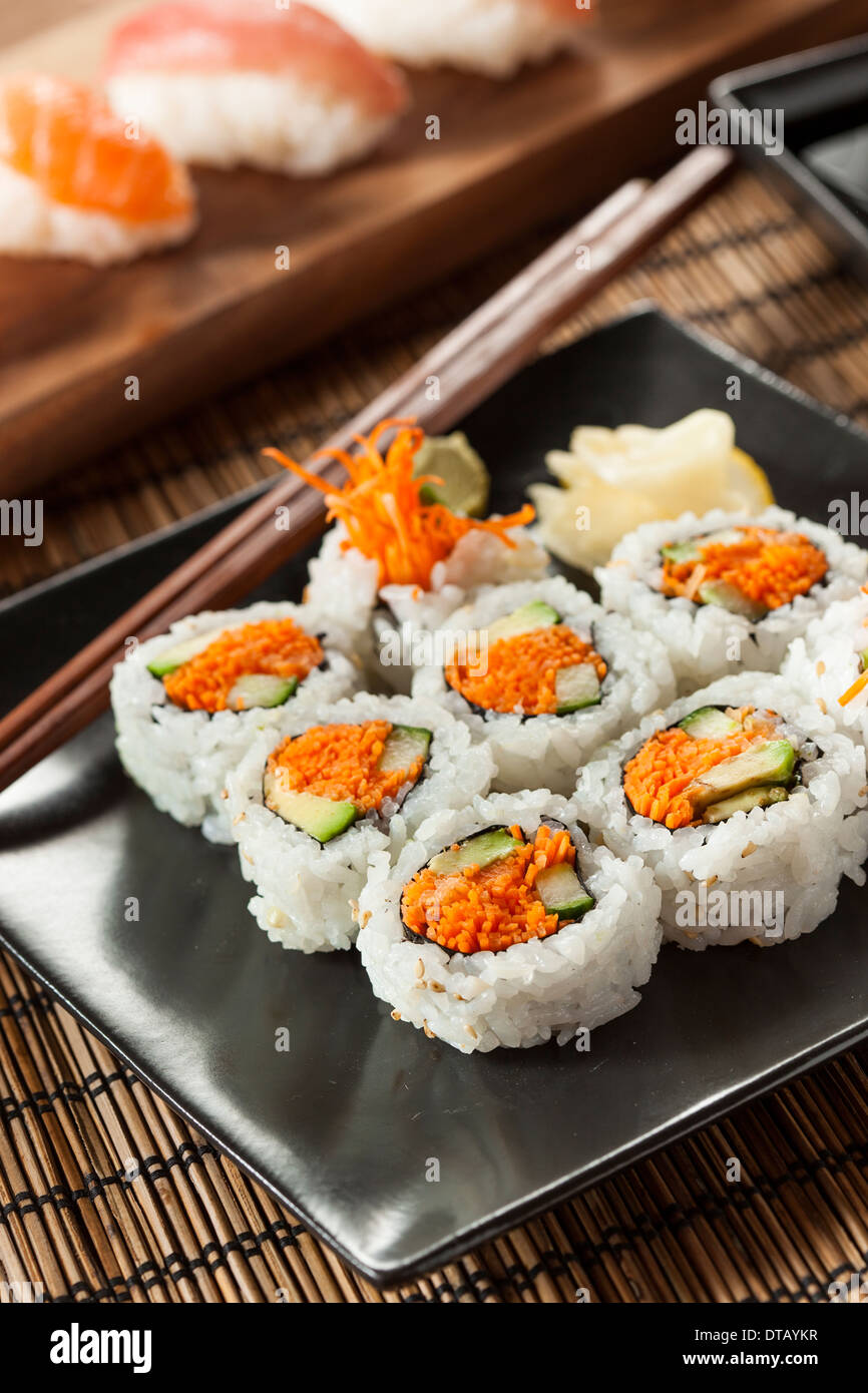 Healthy Japanese Vegetable Maki Sushi Roll with Rice and Fish - Stock Image