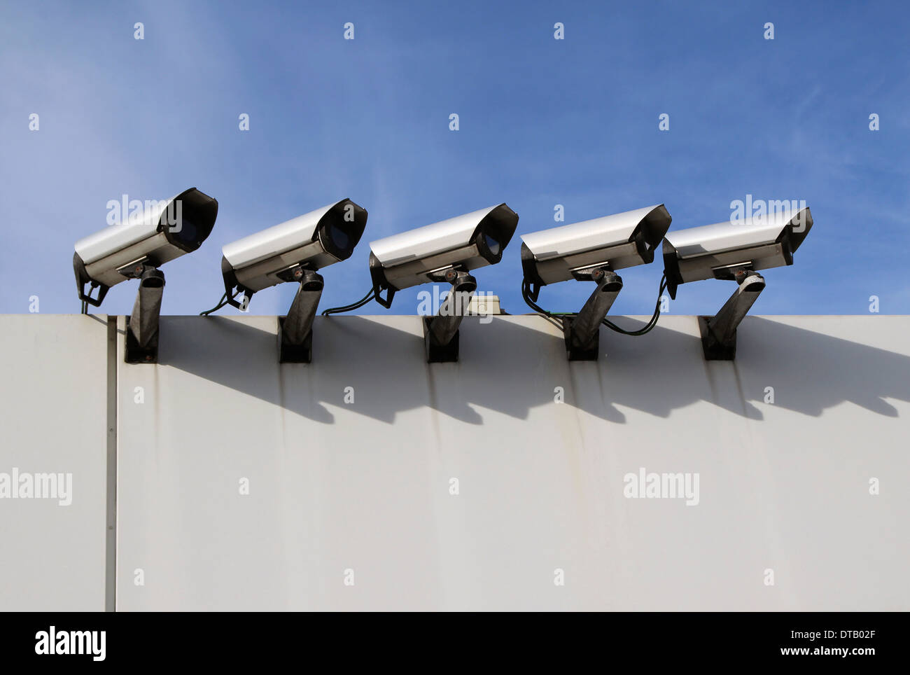 Closed circuit television on wall - Stock Image