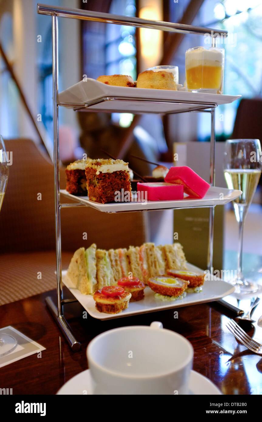 Champagne cream tea in London hotel. - Stock Image