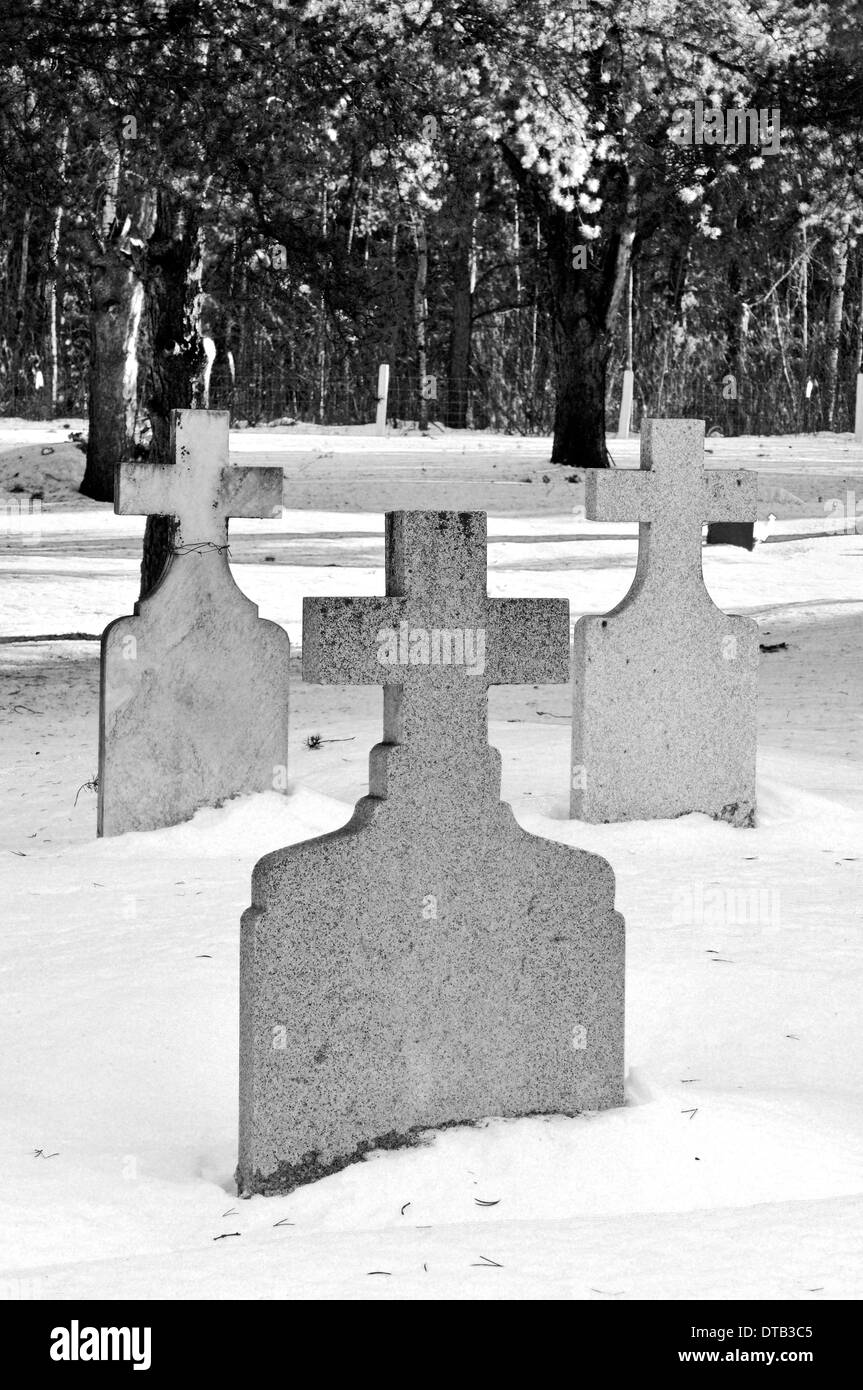 Three crosses made of stone and used as grave markers - Stock Image