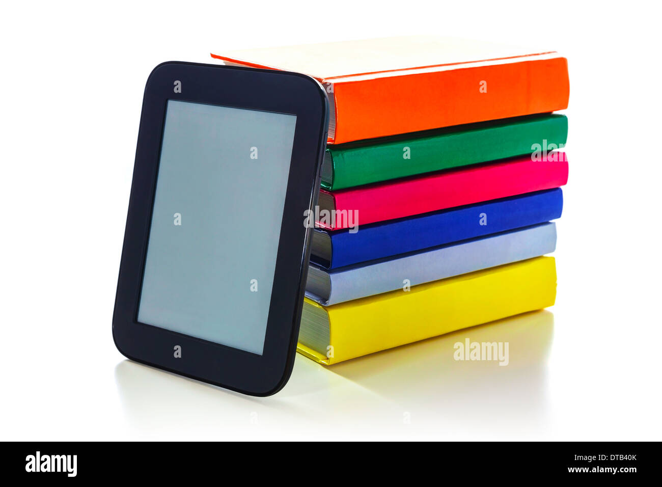 Electronic book reader with a pile of hard cover books - Stock Image