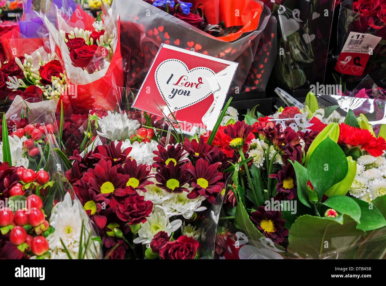 The usual price increase for Valentine flowers does not lessen the popularity of them for a gift on Valentines Day. - Stock Image