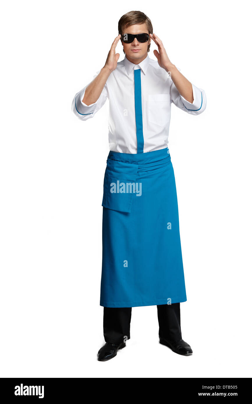 Young man in the form of a waiter or chef, white, red shirt, sunglasses, headdress chef - Stock Image