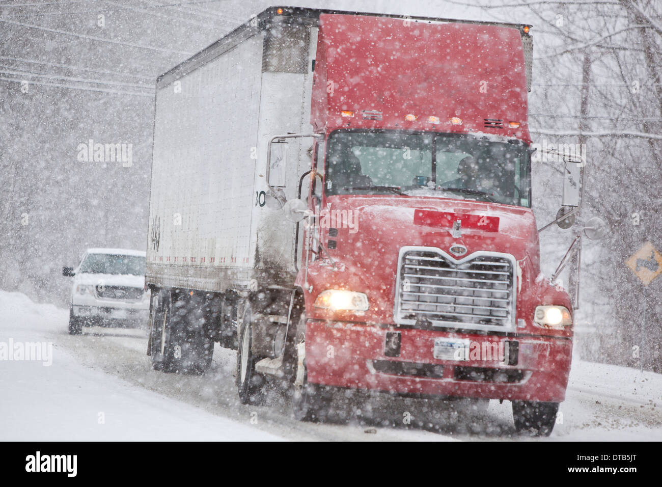 Truck on a highway during a winter storm - Stock Image