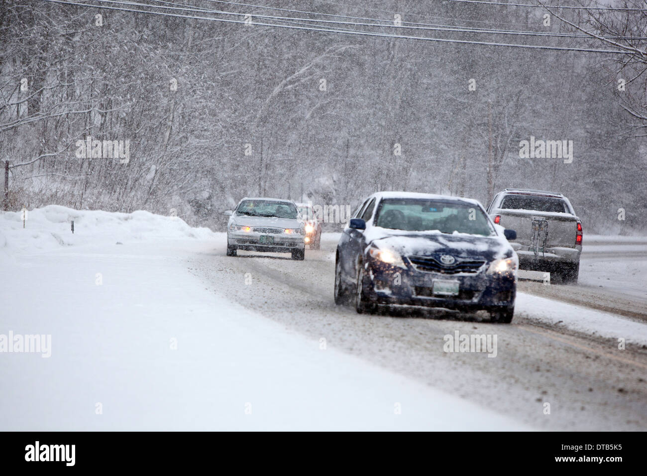 traffic moving during a winter storm in Vermont - Stock Image