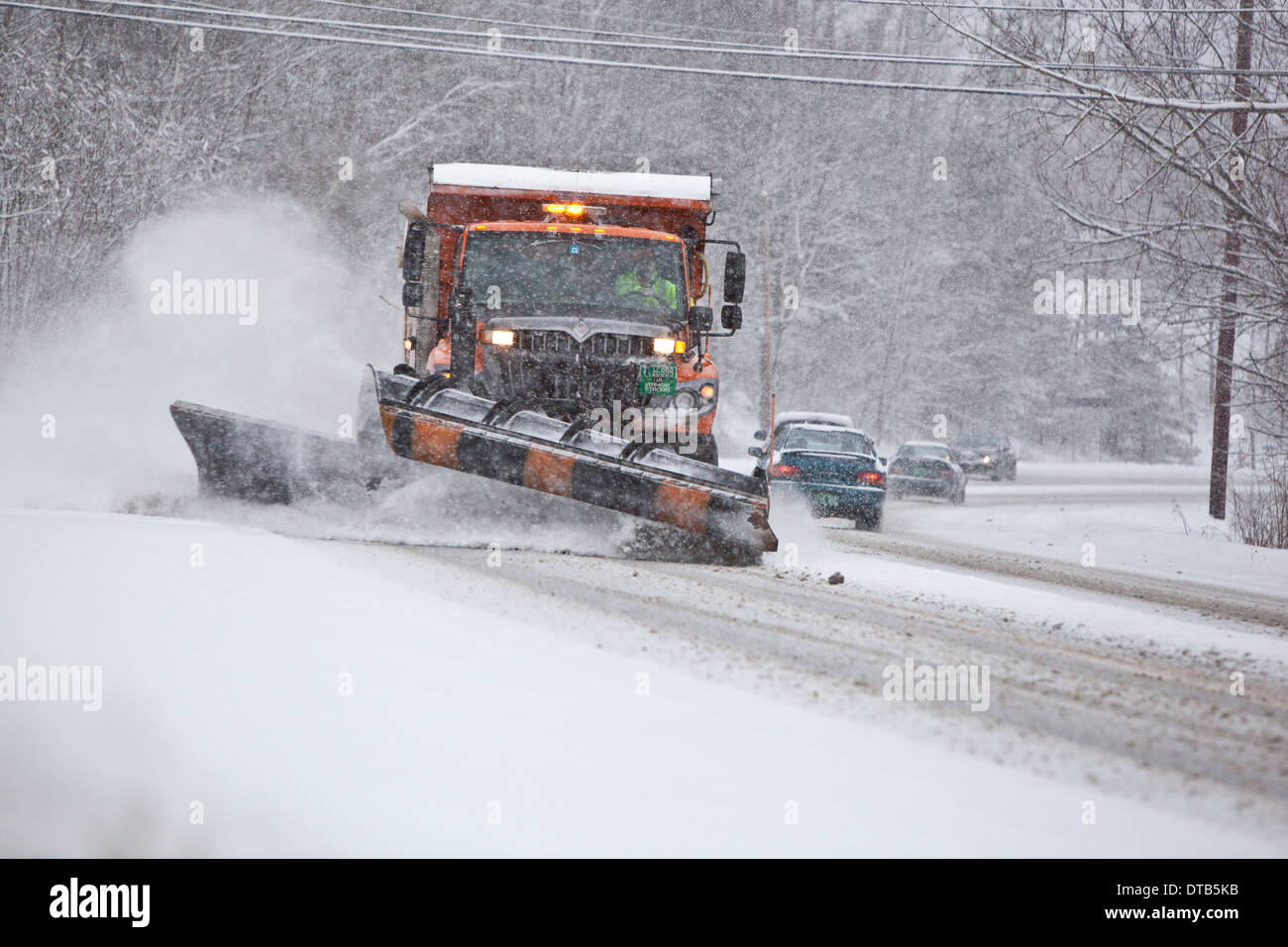 Snowplow on US route 7 in Vermont during a winter storm - Stock Image