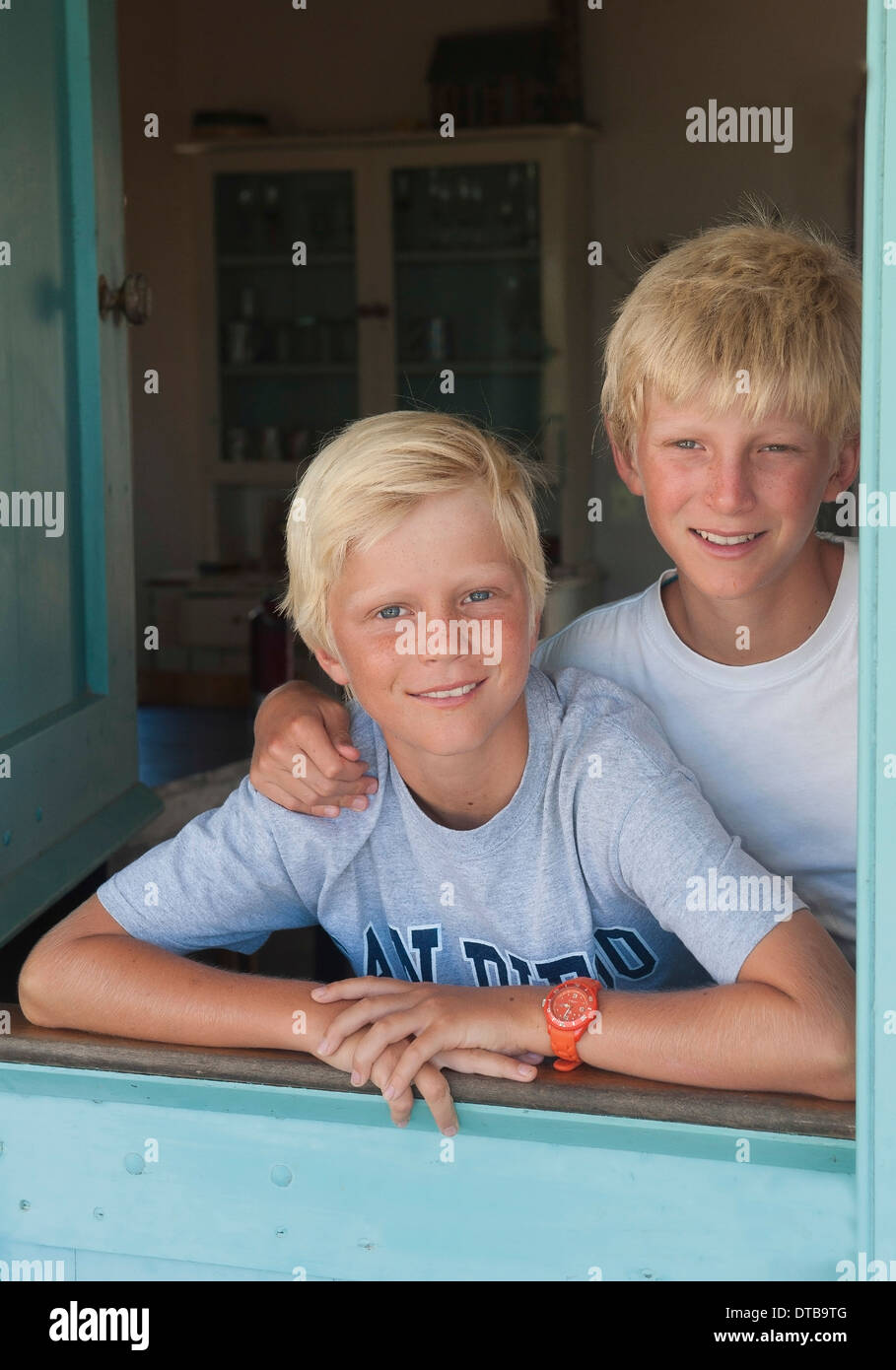 Portrait of two happy blonde brothers, Churchhaven, Western Cape, South Africa - Stock Image